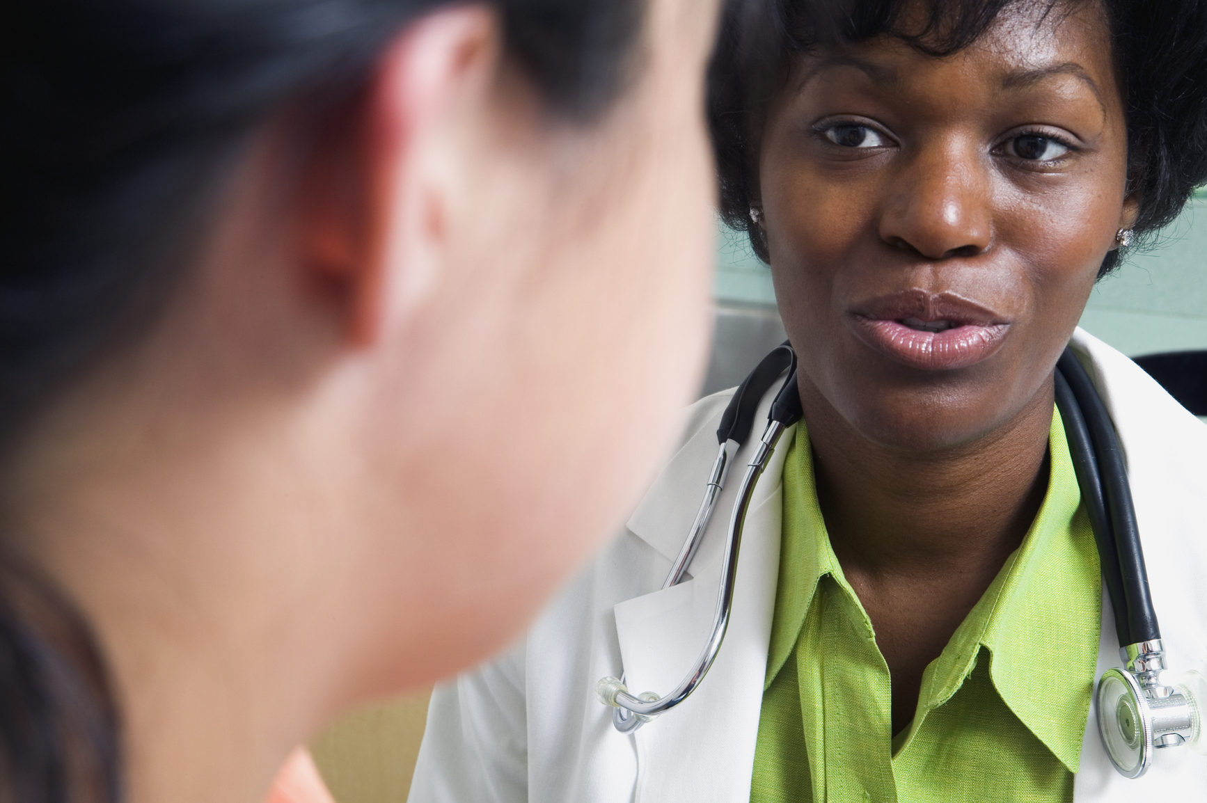 Close up of doctor talking to patient