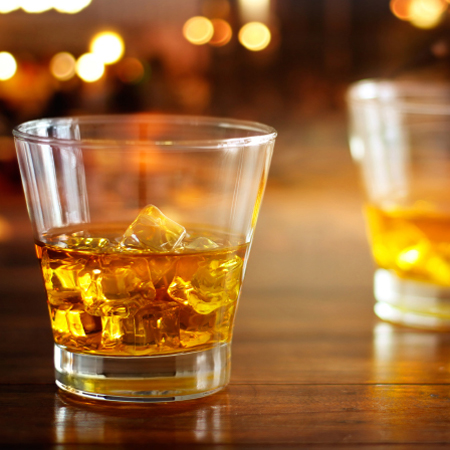 Photo: liquor glasses on bar.